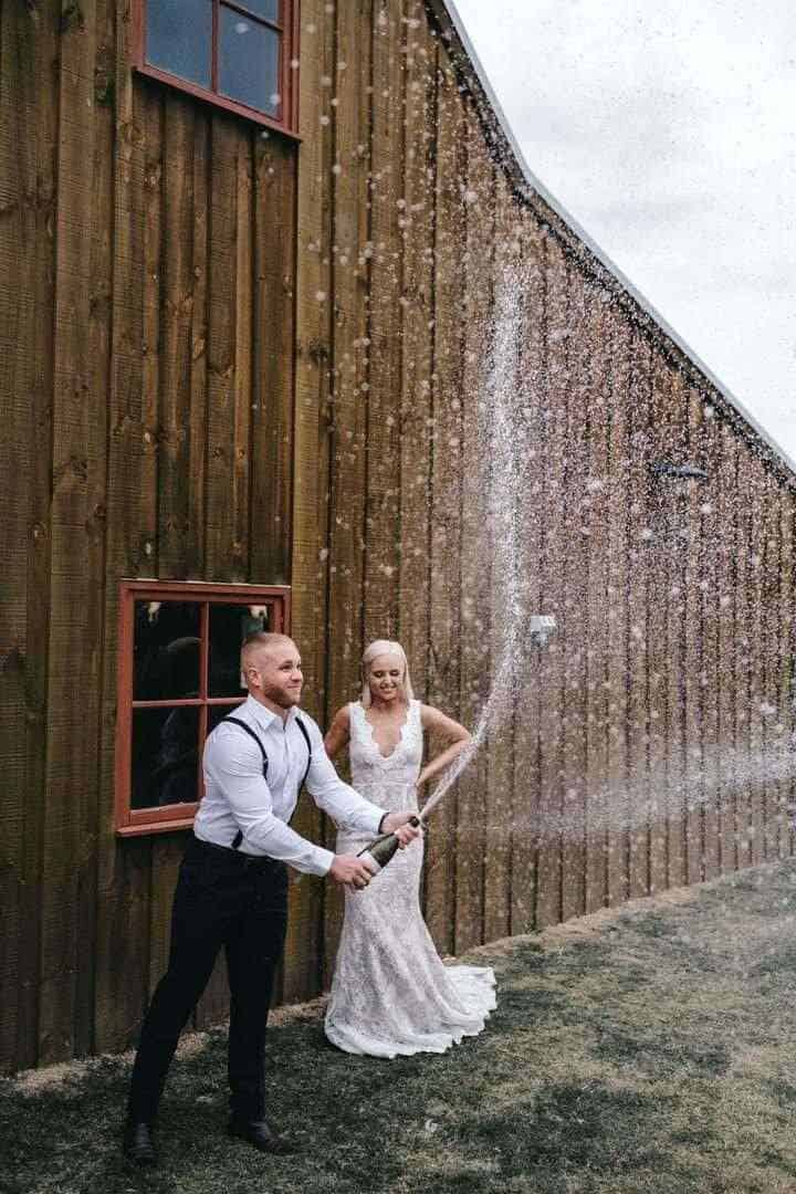 newly-weds popping champagne