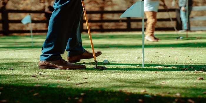 person holding a golf club